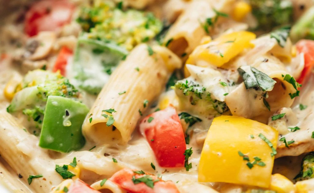 White sauce pasta with lots of vegetables